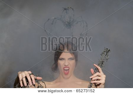 Screaming Queen With Symbols Of Power
