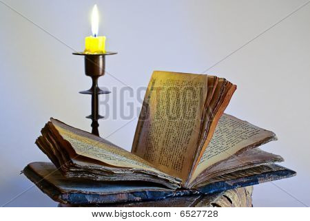 Old Religious Book And Candlestick With Candle