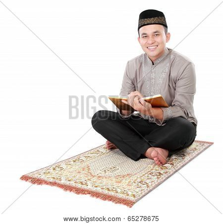 Muslim Man Holding And Reading Quran
