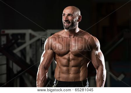 Mature Muscular Man Flexing Muscles