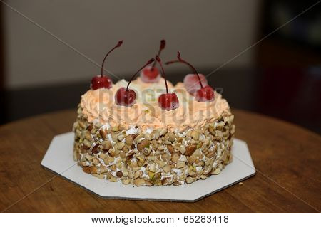 A pretty cake isolated on a dinner table