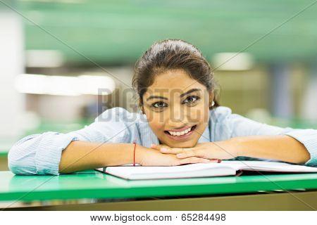 pretty female college student with book