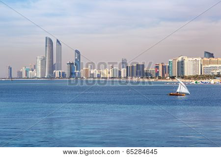 ABU DHABI, UAE - MARCH 29: Skyscrapers at Persian Gulf in Abu Dhabi on March 29, 2014, UAE. Abu Dhabi is the capital and the second most populous city of the United Arab Emirates.