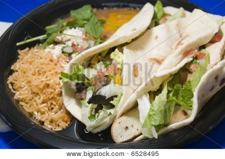 Combination Steak Fajita And Chicken Fajita With Refried Beans And Rice