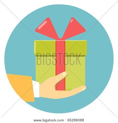 hand holding green gift box