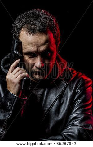 Private detective with leather jacket and gun, pointing