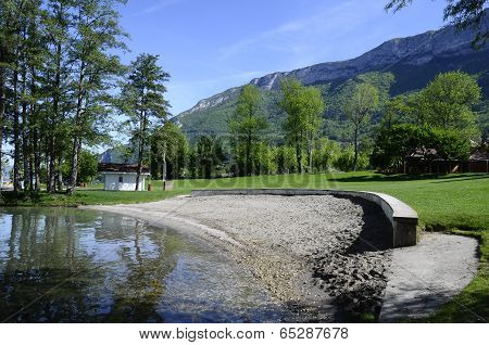 Sand beach and lawn on Annecy lake
