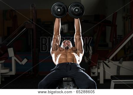 Mature Man Doing Dumbbell Incline Bench Press Workout