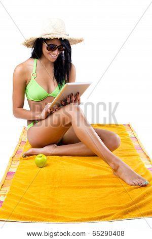 Happy Young Girl With Green Bikini And Digital Table