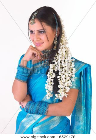 Beautiful girl with long jasmine flowers
