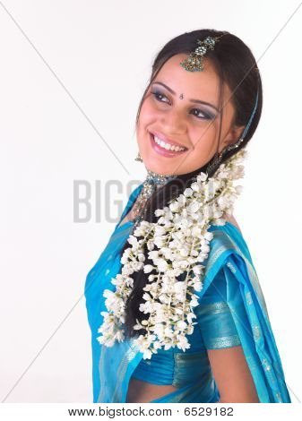 teenage asian girl with jasmine flowers