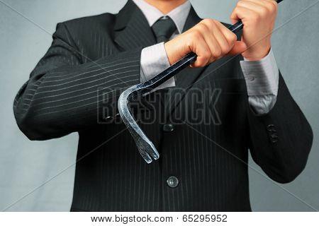 Man Holds Metal Crowbar