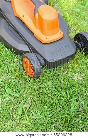 Electric Lawnmower On Green Grass