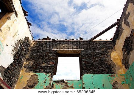 Old Wall Ruins Of A House Against Sky