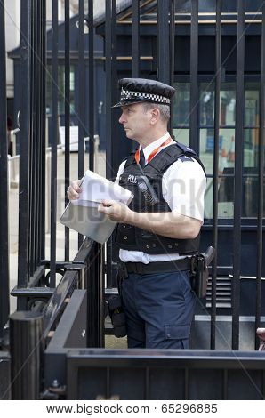 LONDON, UK - MAY 14, 2014  - Policemen on duty, Security officers in front of PM s residence at Down