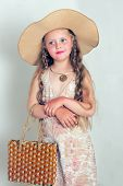foto of little girls photo-models  - The photo shows a little girl she tries to imitate adults and look fashionable and stylish - JPG