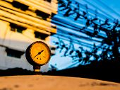 foto of air pressure gauge  - The old pressure gauge of watertank at sunset - JPG