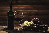 pic of wooden basket  - Bottle of red wine - JPG