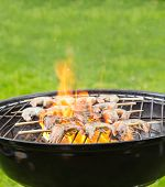 stock photo of barbie  - Delicious grilled prawns on burning coals - JPG