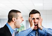 picture of angry  - Angry businessman shouting to an employee - JPG