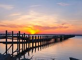 stock photo of virginia  - Colorful skies at sunset with pier from Chincoteague Island - JPG