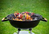 image of braai  - Tasty skewers on the grill - JPG