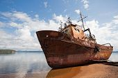 picture of shipwreck  - Old fishing vessel on the sea coast in sunny day - JPG