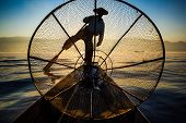 stock photo of shan  - Silhouette fishermen in Inle Lake at sunrise Inle Shan State Myanmar - JPG