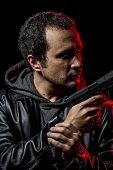 stock photo of private detective  - Private detective with leather jacket and gun - JPG