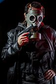 foto of chemical weapon  - Private detective with bulletproof vest and gas mask - JPG