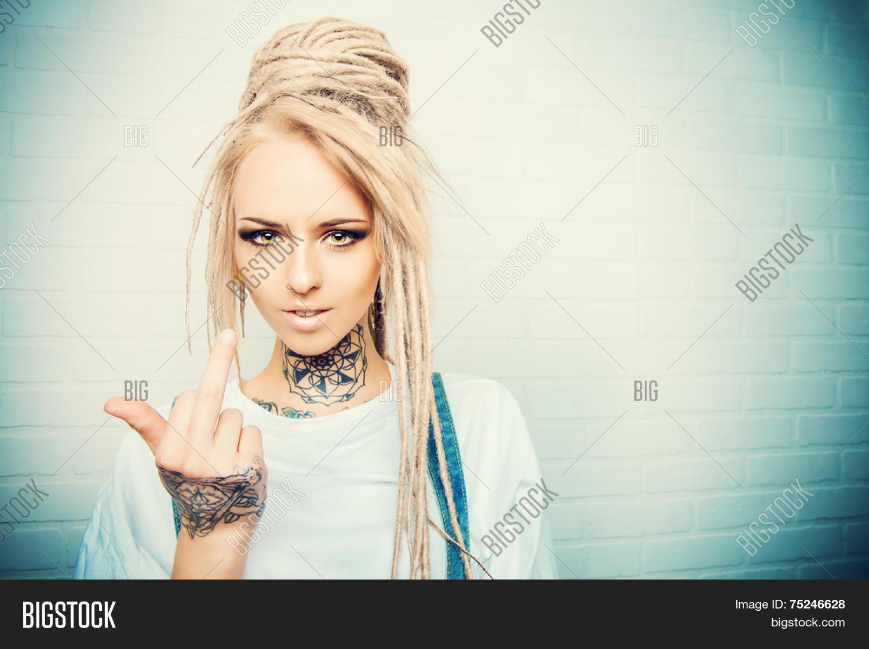 Modern teenage girl with blonde dreadlocks standing by the for Modern teenage girl