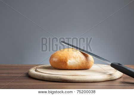 Bread Roll With Knife On Plate