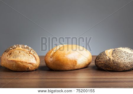 Three Bread Rolls On Table