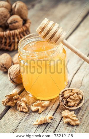 Honey In Glass Jar, Walnut In Basket And Wooden Dipper