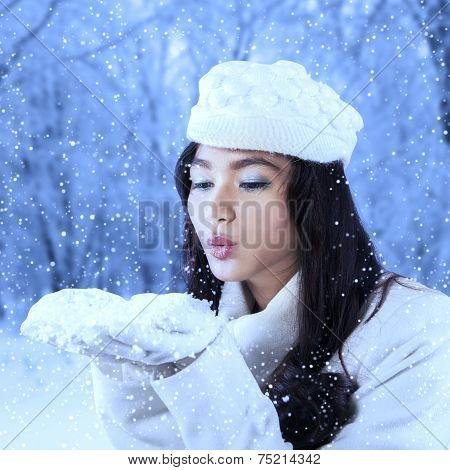 Girl Blowing Snow Outdoor