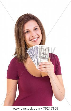 Pretty brunette showing wad of cash on white background
