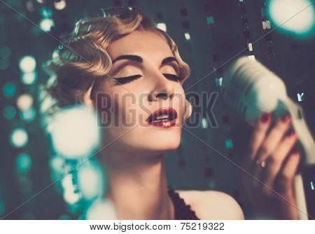 Elegant blond retro woman singer with beautiful hairdo