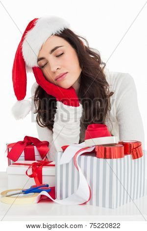Brown hair in santa hat napping instead of wrapping gifts on white background