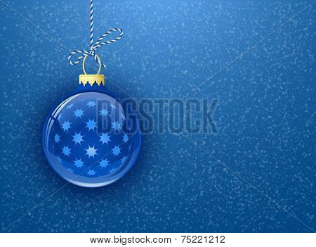 Christmas card with copy space. Christmas bauble on blue background with snowflakes