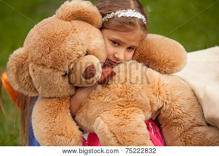 Photo Of Sad Little Girl Hugging Teddy Bear