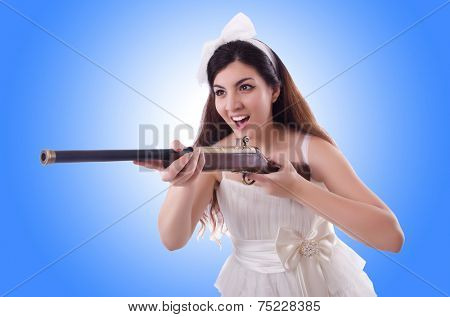 Bride with rifle isolated on white