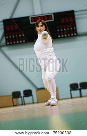 Young woman fencer with epee