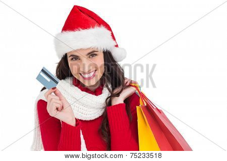 Excited brunette holding shopping bags and credit card on white background