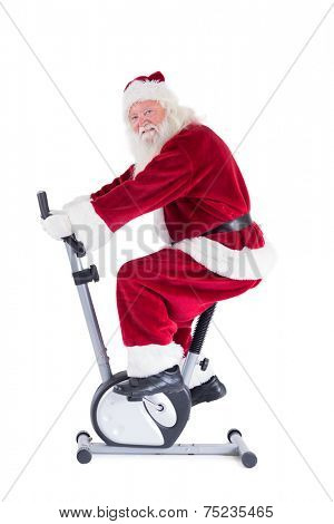 Santa uses a home trainer on white background