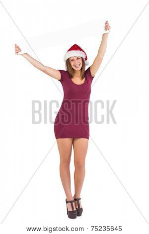 Girl standing upright while holding a poster above her head on white background