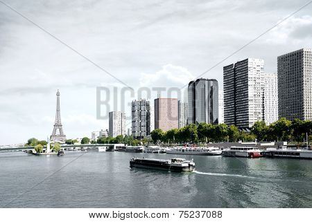 Paris, barge on the Seine and Eiffel tower, view from a bridge