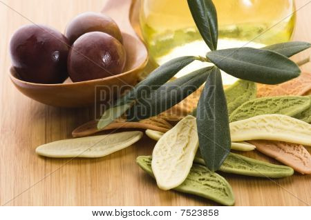 Pasta, Black Olives, Oil With Fresh Branch. Food Ingredients