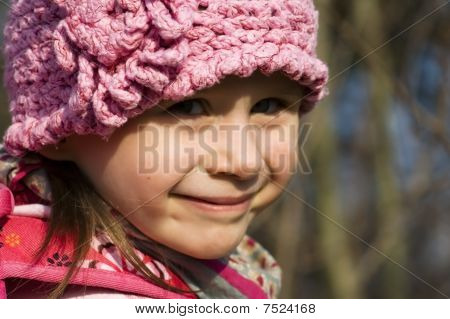 Little Toddler Girl Playing In A Forest