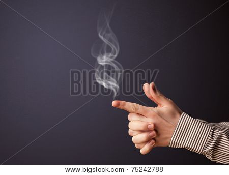 Gun shaped man hand with smoke