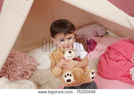 Child Play: Girl Hugging Stuffed Bear Toy